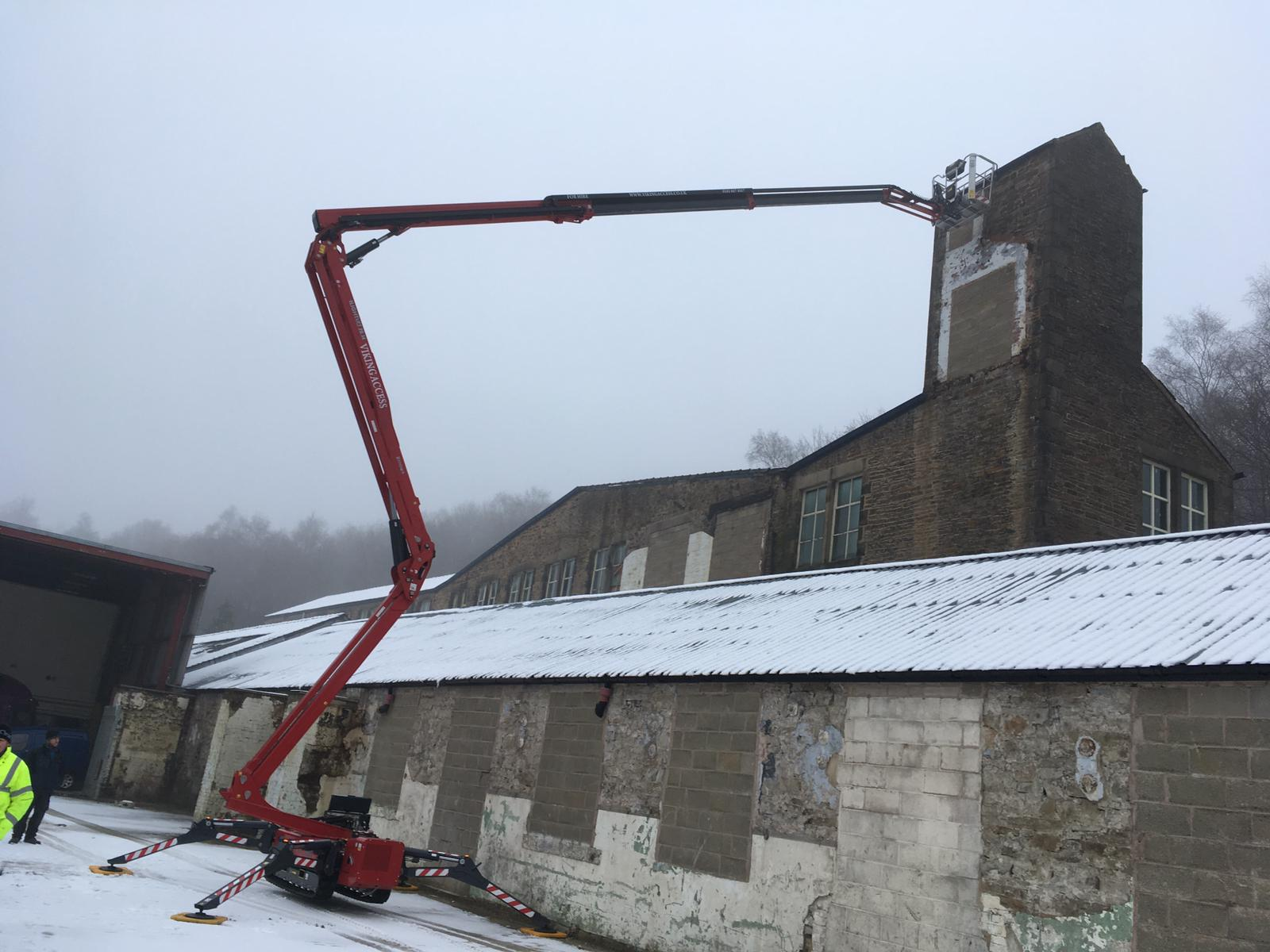 Tracked Boom Specialist Saves the Day for Property Developer