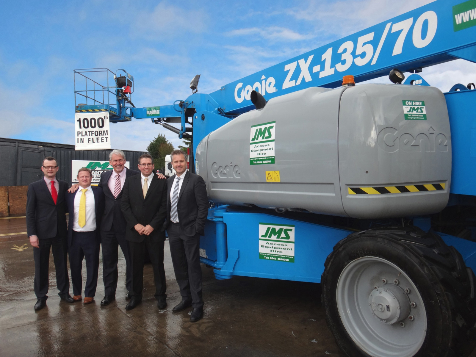 Jim, centre, hands over a boom to JMS Access