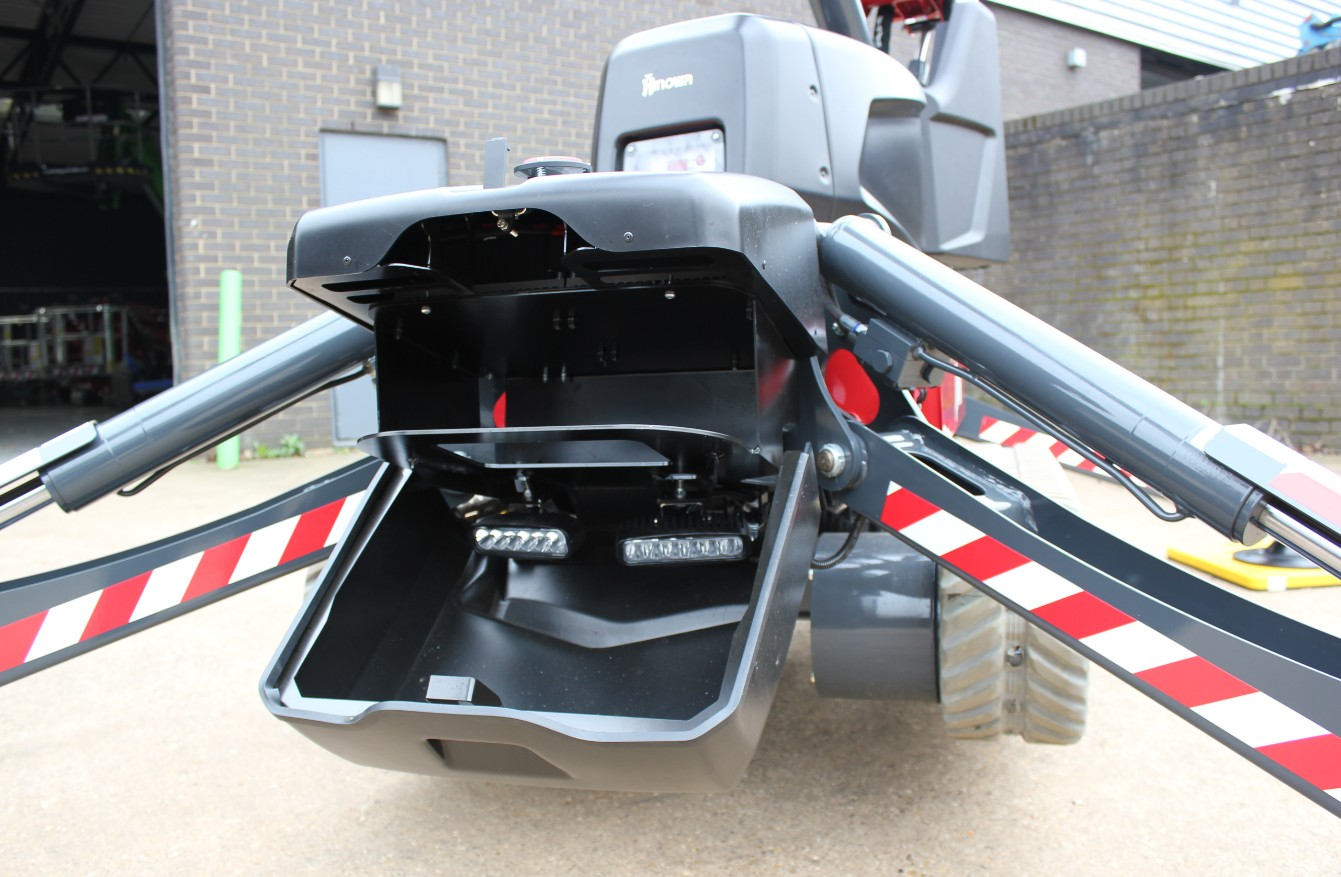 The Hinowa TeleCrawler13 comes with its own storage space for outrigger pads